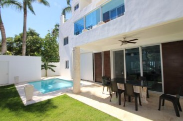 New modern home in popular beachside gated community